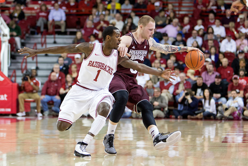 FAYETTEVILLE, AR - JANUARY 23:  Mardracus Wade #1 of the Arkansas Razorbacks tries to steal the ball from Colin Borchert #3 of the Mississippi State Bulldogs at Bud Walton Arena on January 23, 2013 in Fayetteville, Arkansas. The Razorbacks defeated the Bulldogs 96-70.  (Photo by Wesley Hitt/Getty Images) *** Local Caption *** Mardracus Wade; Colin Borchert
