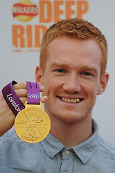 © Licensed to London News Pictures. 29/08/2012. London,UK.Greg Rutherford attending to the launch of new Walkers Deep Ridged crisps.To celebrate the launch Walkers will unveil 'Britain's Biggest Ever Crisp', a 22m high x 26m .Photo credit : Thomas Campean/LNP. .