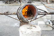 Molten metal is moved and poured - Nic Fiddian-Green (pictured in white shirt - sculptor of monumental neo-classical horses heads) sets up his iron foundry in Bruton Place, Mayfair to demonstrate the ancient art of 'lost wax' casting and also hand patinating.  He also has a new solo show at Sladmore Contemporary from 10th June until 31st July 2015. The exhibition will include a recreation of the artist's hilltop surrey studio and workshop,  with new work in  progress.
