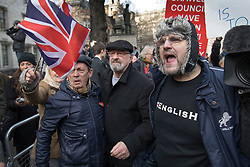 © Licensed to London News Pictures. 05/12/2016. London, UK. Pro-Brexit demonstrators protests outside the Supreme Court in Westminster, London on the first day of a Supreme Court hearing to appeal against a November 3 High Court ruling that Article 50 cannot be triggered without a vote in Parliament. Photo credit: Peter Macdiarmid/LNP