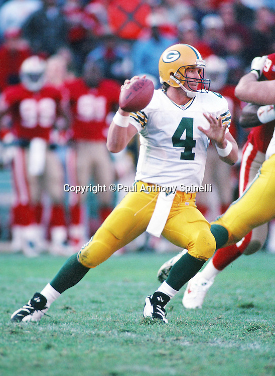 Green Bay Packers quarterback Brett Favre (4) drops back to pass during the NFL NFC Divisional Playoff football game against the San Francisco 49ers on Jan. 6, 1996 in San Francisco. The Packers won the game 27-17. (©Paul Anthony Spinelli)