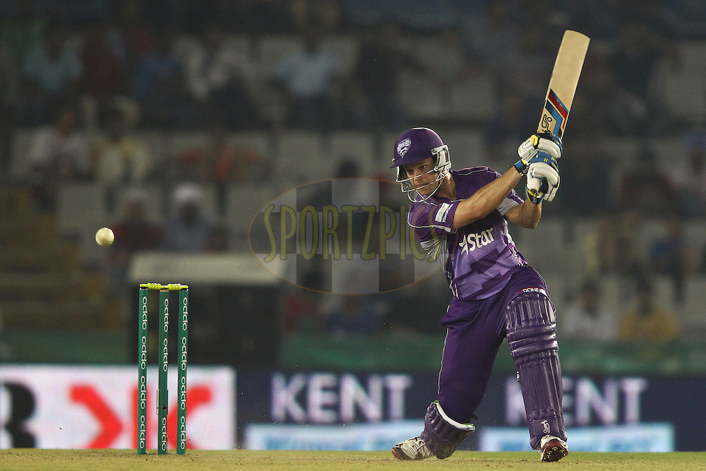 Evan Gulbis of the Hobart Hurricanes drives a delivery through the covers during match 2 of the Oppo Champions League Twenty20 between the Kings XI Punjab and the Hobart Hurricanes held at the Punjab Cricket Association Stadium, Mohali, India on the 18th September 2014<br /> <br /> Photo by:  Shaun Roy / Sportzpics/ CLT20<br /> <br /> <br /> Image use is subject to the terms and conditions as laid out by the BCCI/ CLT20.  The terms and conditions can be downloaded here:<br /> <br /> http://sportzpics.photoshelter.com/gallery/CLT20-Image-Terms-and-Conditions-2014/G0000IfNJn535VPU/C0000QhhKadWcjYs
