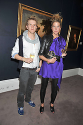 JOSEPHINE PAPASAVVAS and DUNCAN MACDONALD at a party to celebrate the publication of Elena Makri Liberis's book 'Every Month, Same day' held at Sotheby's, 34-35 New Bond Street, London on 5th May 2009.