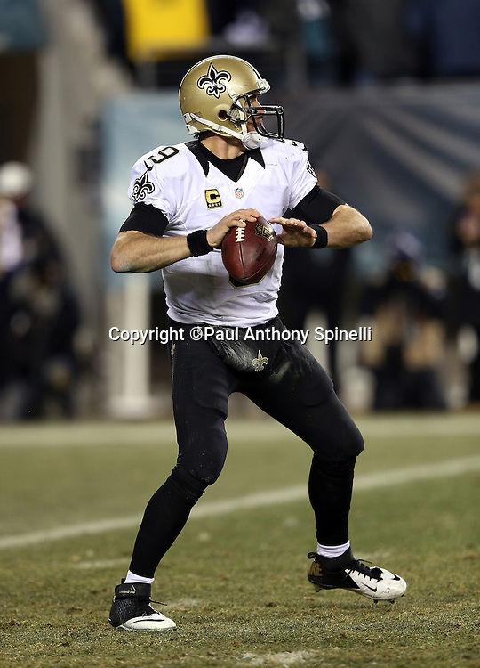 New Orleans Saints quarterback Drew Brees (9) throws a pass during the NFL NFC Wild Card football game against the Philadelphia Eagles on Saturday, Jan. 4, 2014 in Philadelphia. The Saints won the game 26-24. ©Paul Anthony Spinelli