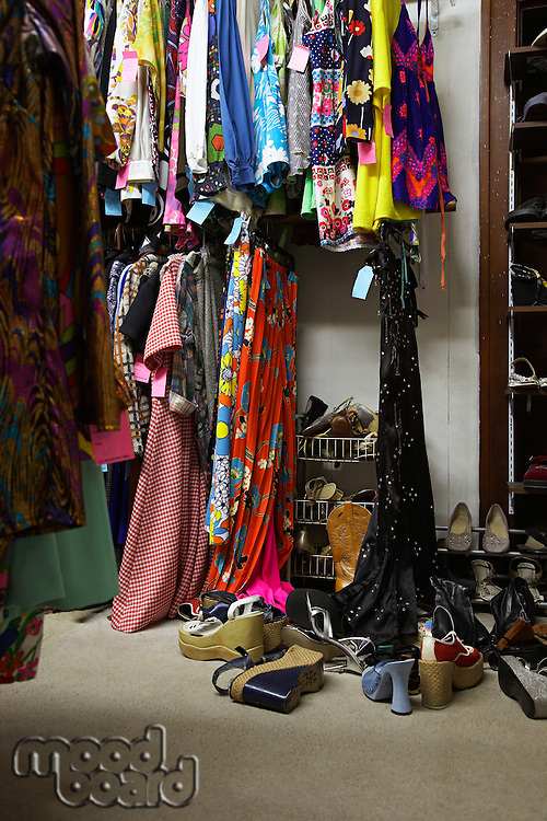 Crowded Clothing Racks and Piled Shoes in Second Hand Store