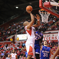 Jan 31, 2009; Piscataway, NJ, USA; Rutgers forward Gregory Echenique (00) puts a shot over the reach of DePaul center Mac Koshwal (13) during the first half of Rutgers game against DePaul in NCAA college basketball at the Louis Brown Athletic Center