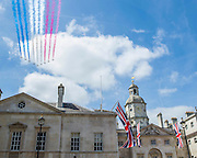 The flypast of the Red Arrows passes over Horse Guards Parade. VE Day 70 commemorations -  marking historic anniversary of end of the Second World War in Europe. following a Service of Thanksgiving at Westminster Abbey, a parade of Service personnel and veterans and a flypast - down whitehall and into Horse Guards Parade.