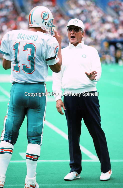 Miami Dolphins quarterback Dan Marino (13) talks to Miami Dolphins head coach Don Shula on the sideline during the NFL football game against the Pittsburgh Steelers on Sept. 30, 1990 in Pittsburgh. The Dolphins won the game 28-6. (©Paul Anthony Spinelli)