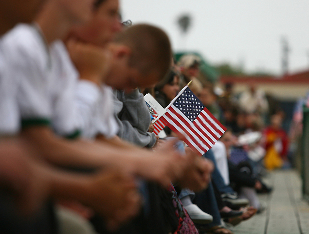 "TORRANCE, CA - JUNE 1: Students morn the loss of Cpl. Joseph Anzack, Jr. at his funeral service at South High School where he graduated in 2005, on June 1, 2007 in Torrance, California. Anzack went missing with two other soldiers when their combat team was ambushed on May 12 near Mahmoudiya, south of Baghdad, Iraq. Al Qaeda claimed responsibility for the attack which killed four other U.S. soldiers and an Iraqi interpreter. Two American soldiers remain missing. Earlier this year, his family breathed a sigh of relief after learning that the rumors of his death which prompted South High School students to post a message on the school marquee reading, ""In Loving Memory - Joseph Anzack - Class of 2005"", turned out to be false. Anzack will be interred at Arlington National Cemetery. Pfc. Joe Anzack was promoted posthumously to Corporal."
