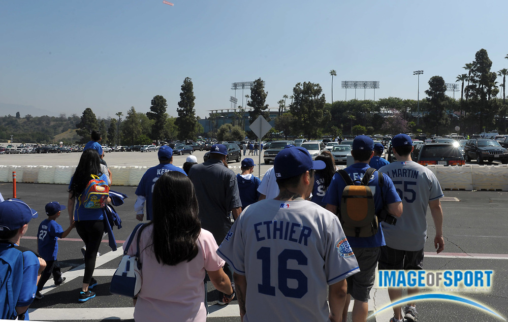 Apr 10, 2012; Los Angeles, CA, USA; Los Angeles Dodgers fans arrive before the 2012 opening day game against the Pittsburgh Pirates at Dodger Stadium.