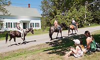 Horses and their riders make their way up to the start of the Sanbornton Old Home Day parade Saturday morning.  (Karen Bobotas/for the Laconia Daily Sun)Sanbornton Old Home Day parade and festivities July 16, 2011..