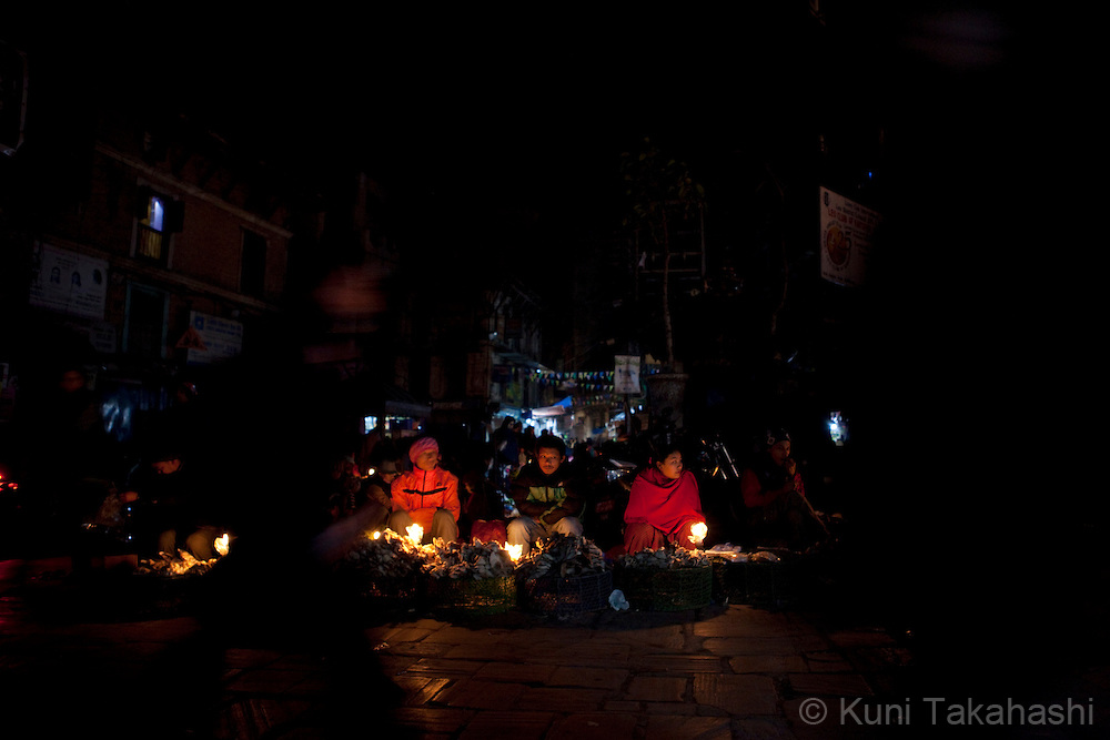 (Jan 3, 2012 - Kathmandu, Nepal).Streets vendors sell vegetables under candle lights during power outage in Kathmandu, Nepal, on Jan 3, 2012. For the last several years, nearly 800,000 people of the capital city faced up to 16 hours of blackouts every day, mainly caused by political instability. Nepal is said to be second only to Brazil in terms of water resources but the government has been incapable of harnessing hydropower..(Photo by Kuni Takahashi)