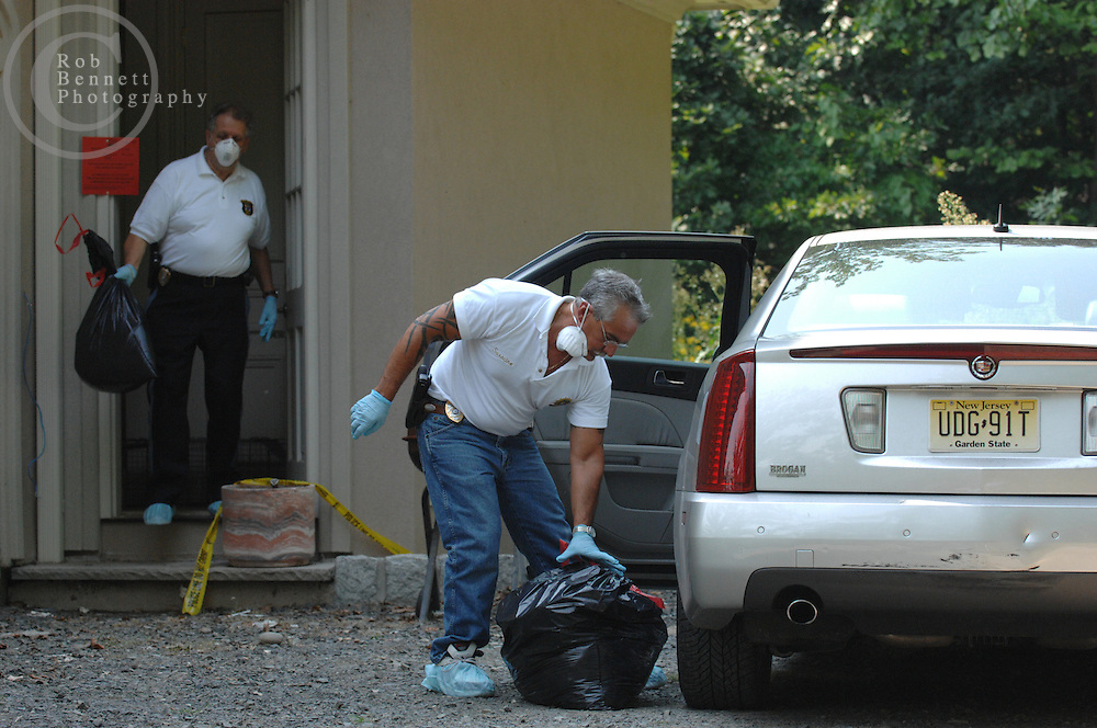 Here, Bergen County SPCA Chief James LaGrosa (L) and Deputy Chief Frank Saracino (R) carry bags of personal items belonging to  Cynthia Stewart, 49, to a Cadillac operated by Mrs. Stewart. Stewart and her husband Philip Tamis, 66 are charged with animal cruelty...---.Saddle River, NJ, - August 16, 2007 - Dozens of cats (most alive, some dead) found neglected in NJ mansion - Authorities Thursday continued to look for animals in a feces-ridden mansion in Saddle River (25 Burning Hollow Road) after removing at least 23 dead cats and dogs and rescuing dozens more pets - perhaps as many as 90...Rob Bennett for The New York Times