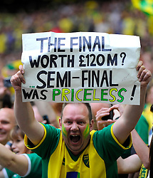 A Norwich City fan celebrates with a sign as they win promotion to the premier league  - Photo mandatory by-line: Joe Meredith/JMP - Mobile: 07966 386802 - 25/05/2015 - SPORT - Football - London - Wembley Stadium - Middlesbrough v Norwich - Sky Bet Championship - Play-Off Final