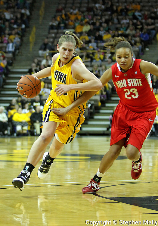 January 08 2010: Iowa forward Kelly Krei (20) tries to get around Ohio St. forward Martina Ellerbe (23) during the first half of an NCAA womens college basketball game at Carver-Hawkeye Arena in Iowa City, Iowa on January 08, 2010. Iowa defeated Ohio State 89-76.