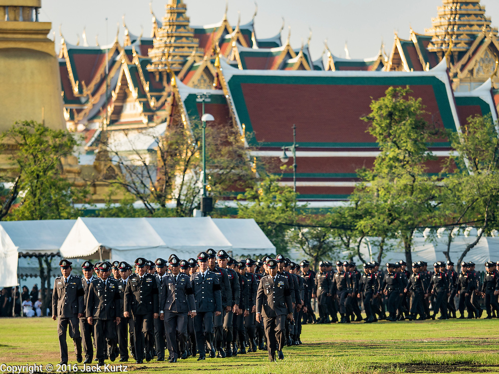 22 NOVEMBER 2016 - BANGKOK, THAILAND: Thai police officers march onto Sanam Luang before a ceremony to honor Bhumibol Adulyadej, the Late King of Thailand,. Hundreds of thousands of Thais gathered across Thailand Tuesday to swear allegiance to the Chakri Dynasty, in a ceremony called Ruam Phalang Haeng Kwam Phakdi (the United Force of Allegiance). At Sanam Luang, the Royal Parade Ground, and location of most of the mourning ceremonies for the late King, people paused to honor His Majesty by singing the Thai national anthem and the royal anthem.        PHOTO BY JACK KURTZ