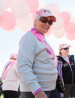 Dottie Simpson and Gayle Bettinger pass through the pink balloon arch at Opechee during Laconia's Making Strides Against Breast Cancer walk.   (Karen Bobotas/for the Laconia Daily Sun)