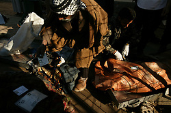 Relatives try to identify bodies overflowing from the morgue at the local hospital, Iskandariyah, Iraq, Feb. 10, 2004. A truck packed with an estimated 500 pounds of explosives blew up at a police statio. Dozens of would-be recruits were lined up to apply for jobs at the station. A hospital official said at least 50 people were killed and 50 others wounded. The local Iraqi police commander, Lt. Col. Abdul Rahim Saleh, said the attack was a suicide operation, carried out by a driver who detonated a red pickup as it passed the station.