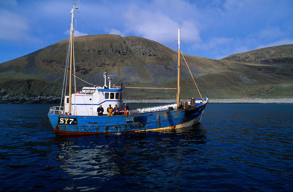 Fishing boat anchored in Village Bay, St Kilda, Scotland.........NIALL BENVIE FISHING BOAT ANCHORED VILLAGE BAY ST KILDA SCOTLAND EUROPE WESTERN ISLES HIRTA TRANSPORT INDUSTRIAL ACTIVITY PRIMARY INDUSTRY HORIZONTAL CALM TRANQUIL REFLECTION ISLAND BLUE WHITE ONE OVER-FISHING SEA MARINE 1996 MAY SPRING DECOMMISSIONING EVACUATION NTS .. Add () this image to a lightbox. Close this window..... .. .. .