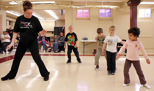 (from left) Teacher Andrea Nelson of the Miami Valley Dance Academy leads, as Garrett Napier, 7; Alexander Zook, 6; Miles Boston, 5 and Madison Sharp, 6 watch and follow along during the first of six hip-hop dance classes at the Carnegie Center in Miamisburg , Saturday, January 28, 2012.