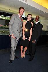 Left to right, BRADLEY WIGGINS, VICTORIA PENDLETON and MO FARAH at the GQ Men of The Year Awards 2012 held at The Royal Opera House, London on 4th September 2012.