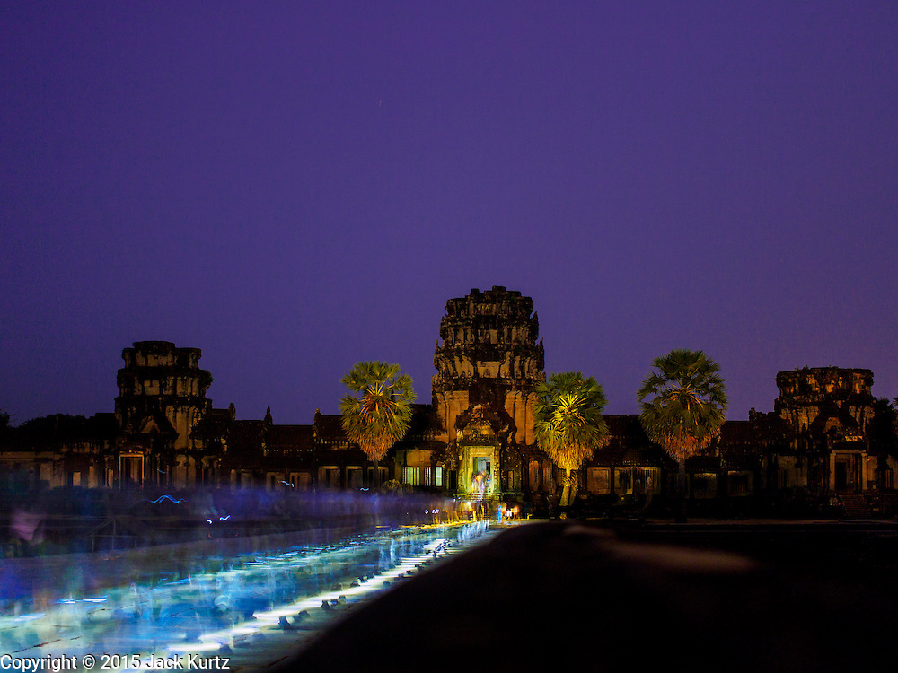 "14 MARCH 2105 - SIEM REAP, SIEM REAP, CAMBODIA:  Tourists use flash lights as the walk into Angkor Wat for the sunrise. Thousands of people walk through the predawn darkness to see the sun come up over Angkor every morning. The area known as ""Angkor Wat"" is a sprawling collection of archeological ruins and temples. The area was developed by ancient Khmer (Cambodian) Kings starting as early as 1150 CE and renovated and expanded around 1180CE by Jayavarman VII. Angkor Wat is now considered the seventh wonder of the world and is Cambodia's most important tourist attraction.   PHOTO BY JACK KURTZ"