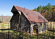 A modern barn at Cades Cove, an isolated valley located in the East Tennessee section of Great Smoky Mountains National Park, USA. Cades Cove was once home to numerous settlers. Today Cades Cove is the most popular destination for visitors to the park, attracting over two million visitors a year, due to its well preserved homesteads, scenic mountain views, and abundant display of wildlife.