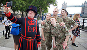 5 Soldiers: The Body is the Frontline <br /> at the Tower of London, Great Britain <br /> 7th September 2017 <br /> Rosie Kay Dance Company <br /> A Beefeater selfie with <br /> Duncan Anderson <br /> Luke Bradshaw<br /> Reece Causton <br /> Harriet Ellis <br /> <br /> perform an extract from the work at the Tower of London - The show will be at military drill hall Yeomanry House, Bloomsbury until 9th September 2017. <br /> <br /> <br /> <br /> Photograph by Elliott Franks <br /> Image licensed to Elliott Franks Photography Services
