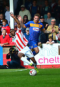 Craig Braham-Barrett is fouled by Bobby Grant during the Sky Bet League 2 match between Cheltenham Town and Shrewsbury Town at Whaddon Road, Cheltenham, England on 25 April 2015. Photo by Alan Franklin.