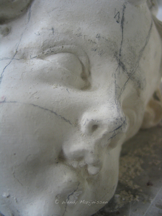 Close up of a statues head in the workshop of one of the restoration classes of the Royal Academy of Arts. Antwerp, Belgium, 2004