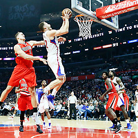 12 December 2016: LA Clippers forward Blake Griffin (32) is fouled by Portland Trail Blazers forward Meyers Leonard (11) during the LA Clippers 121-120 victory over the Portland Trail Blazers, at the Staples Center, Los Angeles, California, USA.