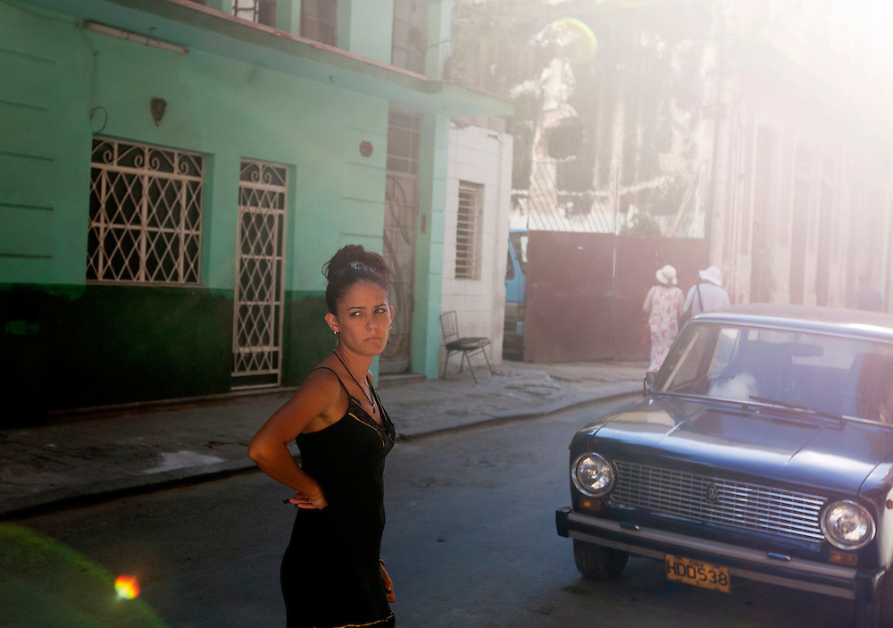 A women stands on the street in Old Havana, Cuba.<br />