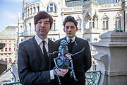 "The director of the current project VRwandlung Mika Johnson (left) and Franz Kafka ""Doppelgänger"" Marek Lentvorsky (21) with the finished model of the insect body by Gregor Samsa portrayed in front of the Prague city Panorama on a balcony of the Goethe Institut."