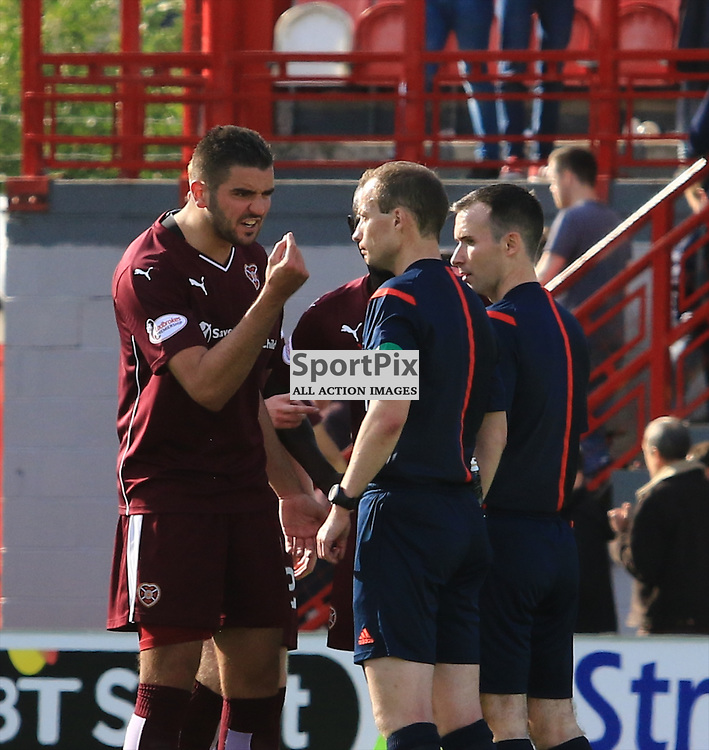 Man of the moment Willie Collum is surrounded by hearts players at the end of the match.....©Edward Linton | SportPix.org.uk