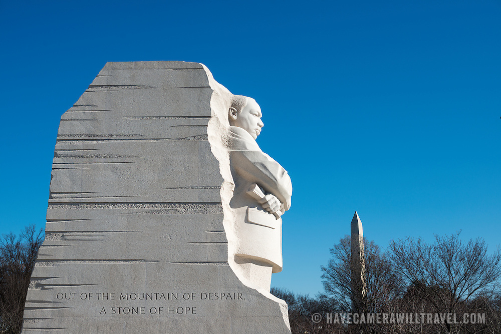 "The statue of civil rights leader Dr Martin Luther King Jr emerging out of the Stone of Hope that forms the centerpiece of the MLK Memorial on the banks of the Tidal Basin in Washington DC. The sculpture was created by Chinese sculptor Lei Yixin. In the background is the top of the Washington Monument. The inscription on the base of the statue reads: ""Out of the mountain of despair a stone of hope."""
