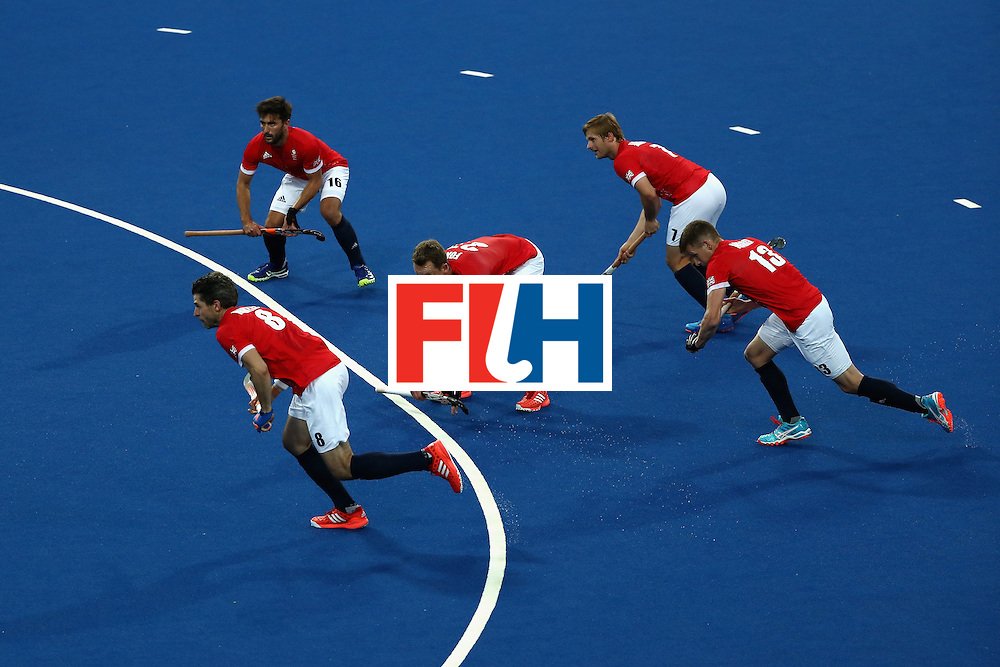 RIO DE JANEIRO, BRAZIL - AUGUST 12:  Sam Ward #13, Simon Mantell #8, Adam Dixon #16, Ashley Jackson #7, and Dan Fox #27 of Great Britain run towards the goal against Spain during a Men's Preliminary Pool B match on Day 7 of the Rio 2016 Olympic Games at the Olympic Hockey Centre on August 12, 2016 in Rio de Janeiro, Brazil.  (Photo by Sean M. Haffey/Getty Images)