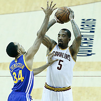 08 June 2016: Golden State Warriors guard Shaun Livingston (34) defends on Cleveland Cavaliers guard J.R. Smith (5) during the Cleveland Cavaliers 120-90 victory over the Golden State Warriors, during Game Three of the 2016 NBA Finals at the Quicken Loans Arena, Cleveland, Ohio, USA.