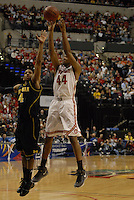 Ohio State forward William Buford takes a jump shot while defended by Michigan guard Darius Morris (4) in the second half of the Big Ten Tournament semifinals in Indianapolis, on March, 11, 2011, at Conseco Fieldhouse. Ohio State defeated Michigan 68-61.