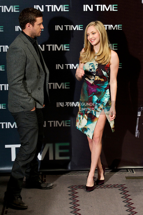 Actor Justin Timberlake and actress Amanda Seyfried attend 'In Time' photocall at Villamagna Hotel on November 3, 2011 in Madrid, Spain.