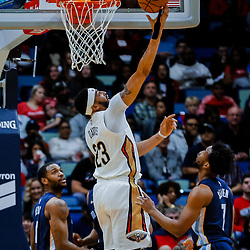 Jan 20, 2018; New Orleans, LA, USA; New Orleans Pelicans forward Anthony Davis (23) shoots over Memphis Grizzlies guard Wayne Selden (7) and forward Jarell Martin (1) during the first half at the Smoothie King Center. Mandatory Credit: Derick E. Hingle-USA TODAY Sports