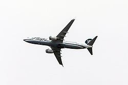 Alaska Airlines Boeing 737-890 (registration N551AS) flies over Palo Alto, California, United States of America