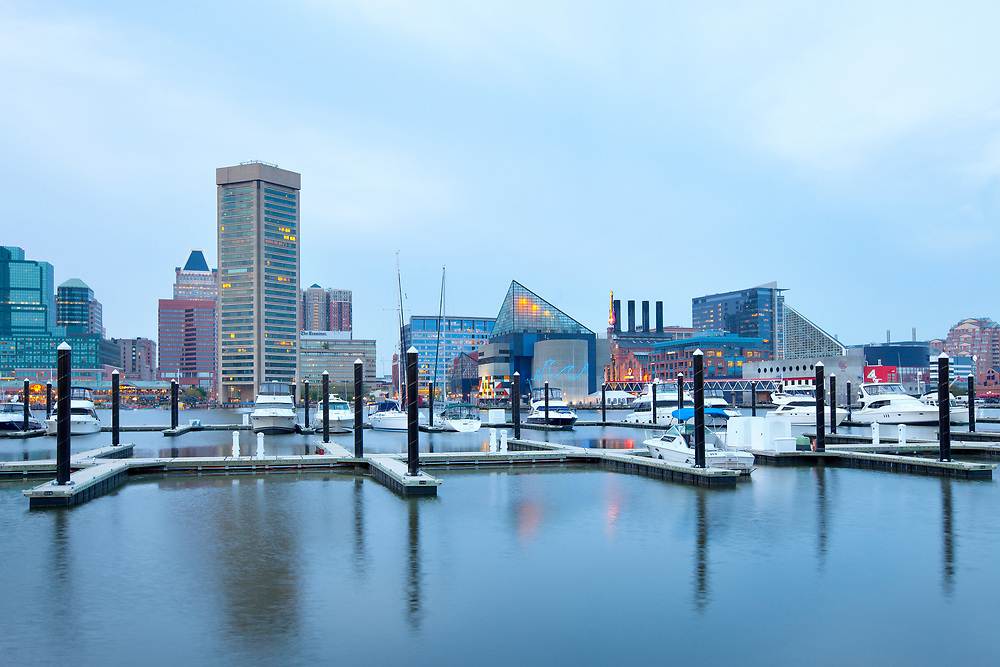 Baltimore, Maryland, United States – April 25, 2011: Downtown city skyline at the Inner Harbor and Baltimore National Aquarium.