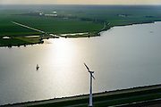 Nederland, Flevoland, Zeewolde, 10-10-2014; Eemmeer met ouder type windturbine in tegenlicht.<br /> Older type wind turbine backlit.<br /> <br /> luchtfoto (toeslag op standard tarieven);<br /> aerial photo (additional fee required);<br /> copyright foto/photo Siebe Swart