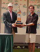 2007 Boyne Tournament of Champions winner Michael Harris accepts the tournaments Walter Burkemo trophy from Boyne Resorts director of eastern operations Steve Kircher.