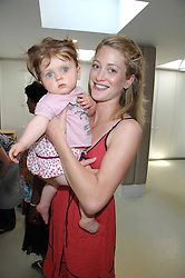 ROSE VAN CUTSEM and her daughter GRACE at a party to celebrate the 21st birthday of the children's charity Starlight held at Maggie & Rose, 58 Pembroke Road, London W8 on 12th May 2008.<br />