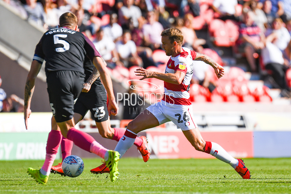 Doncaster Rovers midfielder James Coppinger (26) in action during the EFL Sky Bet League 1 match between Doncaster Rovers and Peterborough United at the Keepmoat Stadium, Doncaster, England on 21 September 2019.