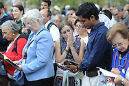 A group of pilgrims pray during the Papal Mass celebrated by Pope Francis Benjamin Franklin Parkway Sunday September 27, 2015 in Philadelphia, Pennsylvania.  (Photo By William Thomas Cain)