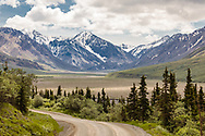 Scenic valley east of Divide Mountain and Toklat River Valley in Denali National Park in Interior Alaska. Summer. Afternoon.