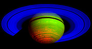 This false colour composite image of Saturn is constructed from data collected in the near-infrared wavelengths of light: blue is used to indicate sunlight reflected at a wavelength of 2 microns, green to indicate sunlight reflected at 3 microns and red to indicate thermal emission at 5 microns. The heat emission from the interior of Saturn is only seen at 5 microns wavelength in the spectrometer data, and thus appears red.