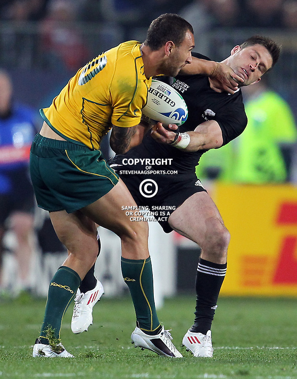 AUCKLAND, NEW ZEALAND - OCTOBER 16, Quade Cooper hands off Cory Jane during the 2011 IRB Rugby World Cup Semi Final match between New Zealand and Australia at Eden Park on October 16, 2011 in Auckland, New Zealand<br /> Photo by Steve Haag / Gallo Images